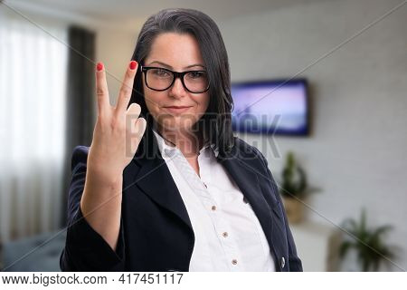 Adult Businesswoman Showing Number Two Using Fingers As Counting Gesture Wearing Smart Casual Suit A
