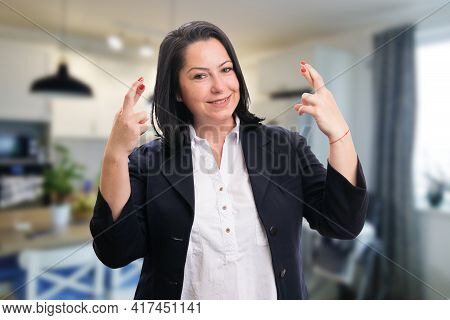 Smiling Woman Entrepreneur Wearing Office Smart Casual Suit Making Double Good Luck Gesture Holding