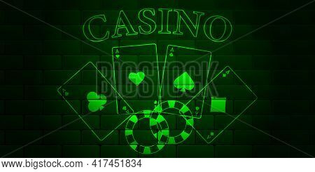 Dark Green Brick Wall With Glowing Text Text Casino, Playing Cards And Casino Chips. Aces Of All Str