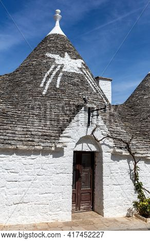 Tradtional White Houses In Trulli Village. Alberobello, Italy. The Style Of Construction Is Specific