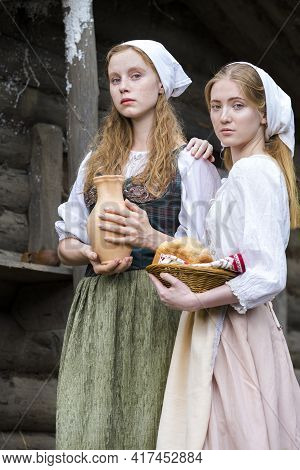 Rural Style Concepts. Two Young Beautful Caucasian Girlfriends In Traditional Rural Outfit  Posing W