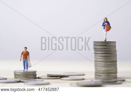 Shopper Woman Holding Shopping Bag And Standing On High Stacking Coins With Shopper Man , Woman Like