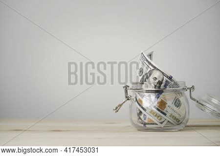 Usd Dollar Banknote Roll Inside Of Saving Jar On Wooden Table And Copy Space , Money Saving For Inve