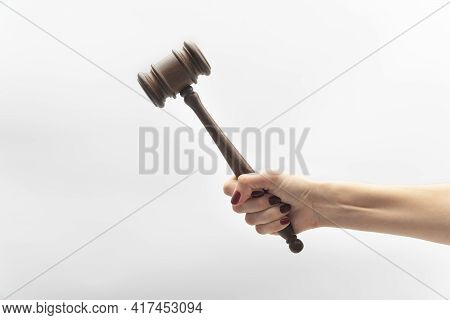Judge Gavel In Female Hand On White Background. Woman Judge Concept