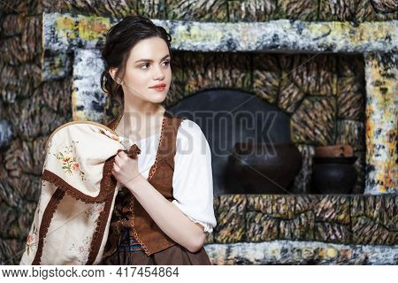 Portrait Of Young Smiling Caucasian Brunette Woman Posing With Fancywork\rhoop In Retro Dress In Rur