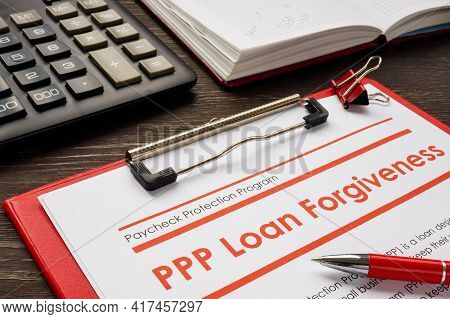 Ppp Loan Forgiveness Form And Red Notebook.