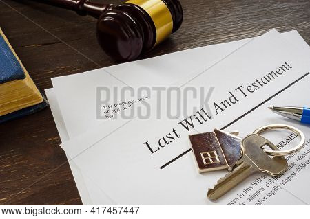 Last Will And Testament Papers And Key As Symbol Of Property.