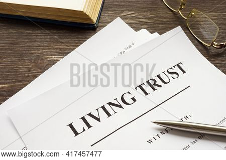 Living Trust Papers With Pen And Book.