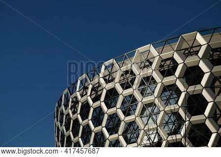 Kazan, Russia - 04 15 2021: Facade Of A Modern Shopping Center. A Wall Composed Of Honeycombs Hexago