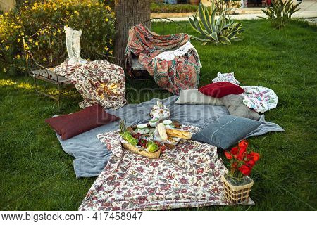 Beautiful Picnic Spot On The Lawn At Sunset In Provence.france