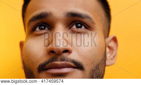 Mid Adult Male Face Looking At Camera Over Orange Background. Portrait Of An Indian Man. High Qualit