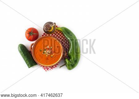 Gazpacho Soup In Crock Pot And Ingredients Isolated On White Background.top View.copy Space