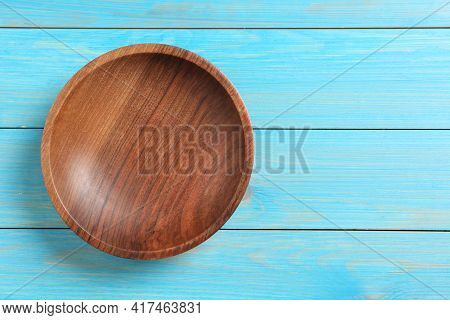 Empty Clean Wooden Plate On Turquoise Table, Top View. Space For Text