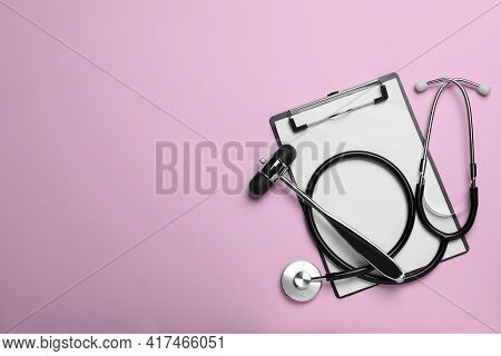 Reflex Hammer, Stethoscope And Clipboard On Pink Background, Flat Lay With Space For Text. Nervous S