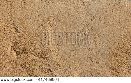 Sand Texture. Sandy Beach For Background. Natural Sand Stone Texture Background. Sand On The Beach A