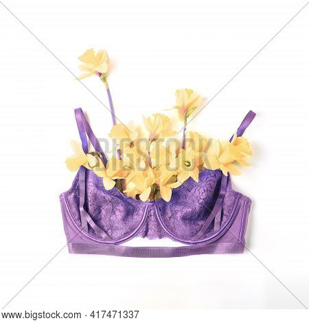 Women's Lace Bra Of Purple Color And Fresh Spring Flowers On A White Background, Top View, Flat Lay.