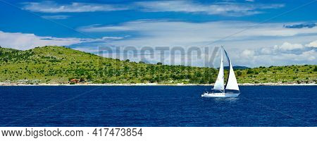 Sailing Ship In Front Of Kornati Islands Of Croatia