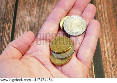 Hand Holds And Counts Euro Cents Coins, Money Stack