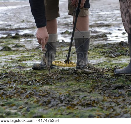 Metal Detecting As A Hobby  A Couble Looking For Discoveries On The Foreshore Between  High And Low
