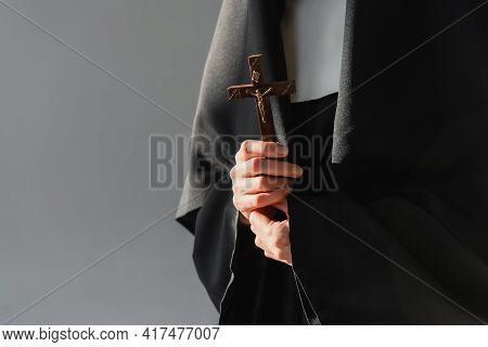 Cropped View Of Nun Holding Crucifix Isolated On Grey.