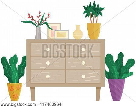 Wooden Commode With Drawers Isolated On White. Photo Frames, Vase With Bouquet, Houseplants