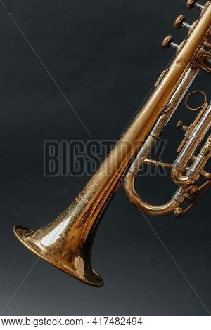 Golden Trumpet. Musical Instrument. Trumpet Bell On Black Background. High Quality Photo