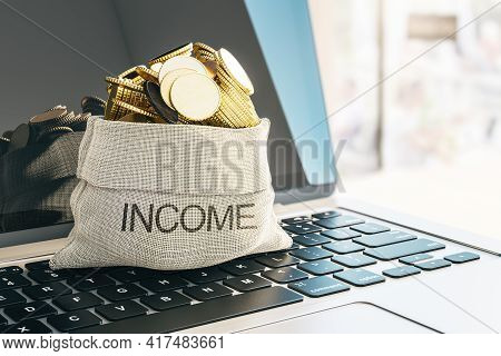 Income And Business Success Concept With Golden Coins In Income Bag On Laptop Keyboard. 3d Rendering