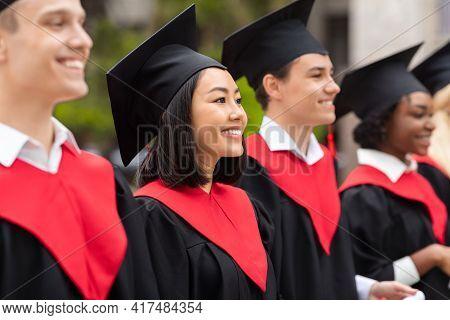 Multiracial Group Of Graduates Having Graduation Ceremony, Closeup