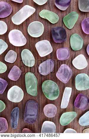 Fluorite Rare Jewel Stones Texture On Brown Varnished Wood Background