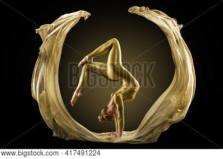 Stretching Woman Performance In Golden Flying Fabric. Yoga Pose Exercising. Art Textile Circle Shape