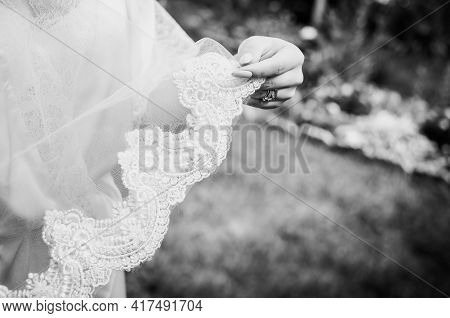 White Veil In The Hands Of The Bride