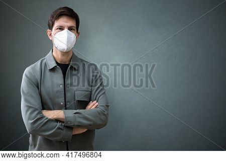 Ffp2 Or N95 Covid Face Mask Man With Crossed Arms