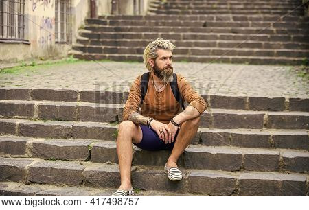 Explore The Back Streets. Bearded Hipster Relax Outdoors. Man Tourist Sit On Stairs. Man With Beard