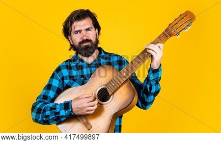 Hipster With Long Hair And Moustache Sing A Song. Male Guitarist With Acoustic Guitar. Music Concept