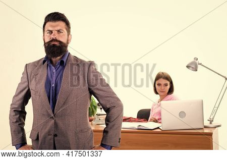 Manager Boss Stand In Front Of Girl Busy With Laptop. Office Manager Or Secretary. Sexy Lady Office