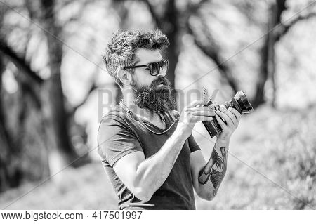 Manual Settings. Photographer Hold Vintage Camera. Modern Blogger. Photographer With Beard And Musta