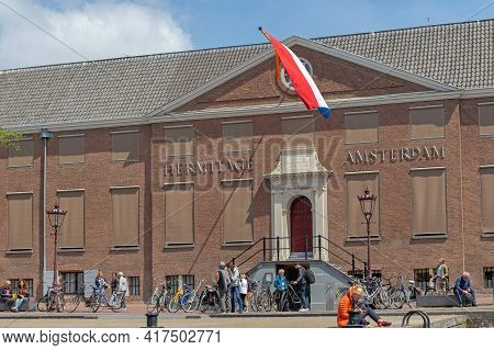 Amsterdam, Netherlands - May 17, 2018: Tourists People In Front Of Hermitage Museum Building In Amst