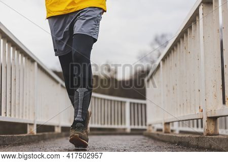 Detail Of Active Man Jogging In The Morning As Part Of Daily Workout Routine