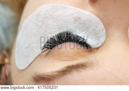 Close-up Of The Eyelashes After The Extension Procedure. The Result Of The Cosmetic Procedure For Ey