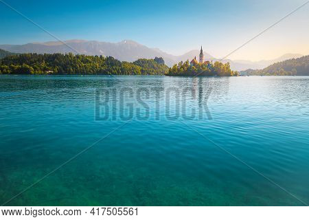 Magical Travel And Recreation Place. Wonderful Lake Bled With Cute Pilgrimage Church On Small Island
