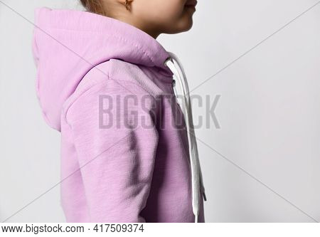 Cropped Studio Shot Of Child Back Isolated On White Background Copy Space. Little Kid Wearing Pink V