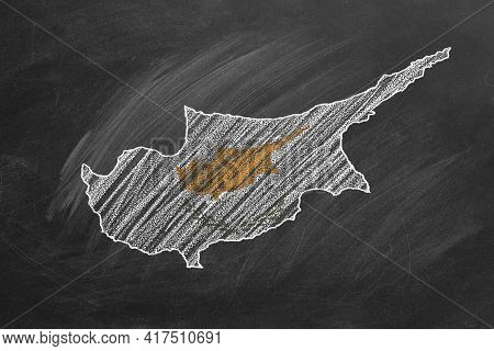 Country Map And Flag Of Cyprus Drawing With Chalk On A Blackboard. One Of A Large Series Of Maps And