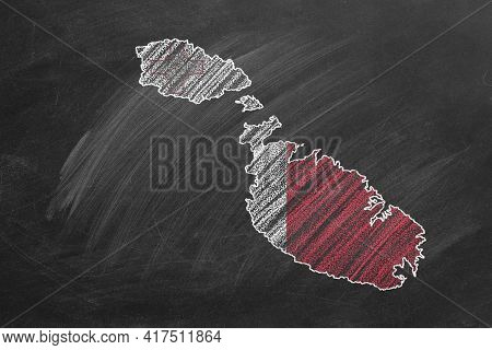 Country Map And Flag Of Malta Drawing With Chalk On A Blackboard. One Of A Large Series Of Maps And