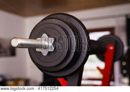 Sport Equipment In Gym. Close-up View Of A Barbells On A Stand In The Room. Selective Fokus.
