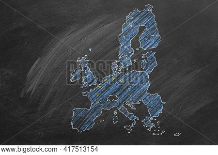 Country Map And Flag Of European Union Drawing With Chalk On A Blackboard. Hand Drawn Animation. One