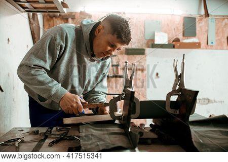 Professional Tinsmith Working With Metal, Workshop. Handmade, Craftsmanship And Blacksmithing Concep