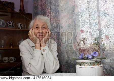 Elderly Sad  Lonely Woman Sitting At Home