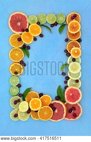 Healthy high fibre fruit high in antioxidants and anthocyanins for immune boost with cranberries, oranges, lemons, limes and grapefruit also high in lycopene and vitamin c. Food health care concept.