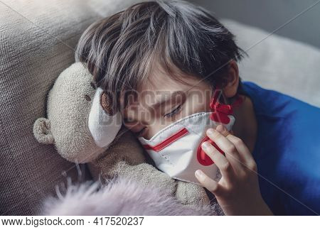 A Boy Tired From Chest Coughing Wearing Medical Face Mask For Protect Pm2.5,child Falling Sleep Whil