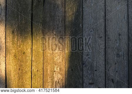 Old Brown Wooden Planks Textured Background With Sunbeam On It.